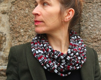 Promo Studio space. Grey/Burgundy/black striped knit scarf or MULTISTRAND necklace