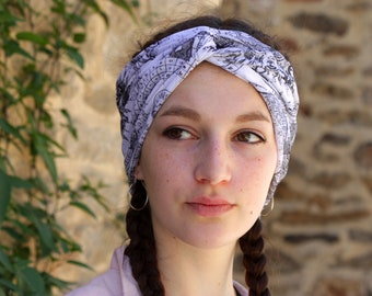 Turban headband was black and white world map pattern. Hair was