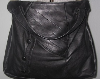 Convertible day bag with pull out laptop sleeve