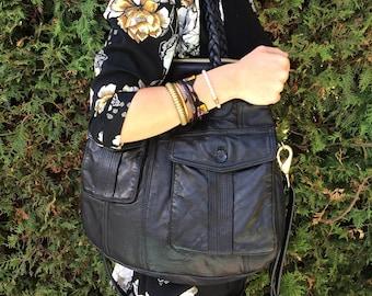 Multi purpose reclaimed leather handbag