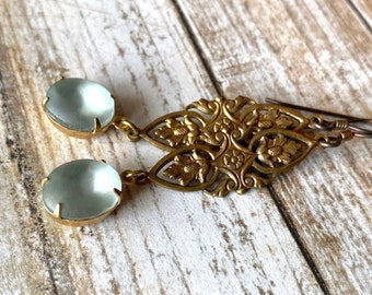 Long filigree earrings with pale blue matte glass drops