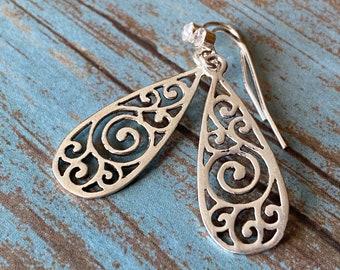 Silver filigree teardrop dangle earrings with rhinestone accents