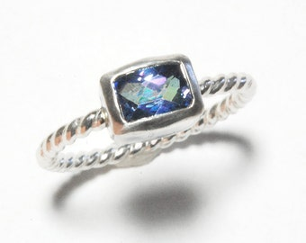 Cushion Topaz Ring with Silver Twist Band and Kashmir Blue Topaz