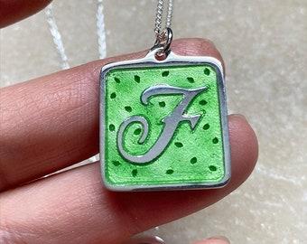Custom handmade silver initial pendant with enamel by Lori Magno