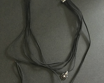 Handmade black suede cord choker necklace with a small black flower charm.