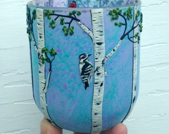 Downy Woodpecker and Birch Trees Sculpted with Polymer Clay onto a Recycled Glass candle Holder in Pale Blue and Purple