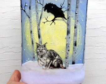 Light Hearted Lynx and Raven on a Snowy Day Sculpted with Polymer Clay onto a Recycled Glass Art Vase in Periwinkle and Pale Yellow