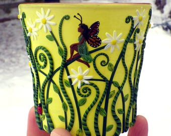 Fairy with Monarch Wing Amongst the Daisies Sculpted with Polymer Clay onto A Recycled Glass Candle Holder in Yellow