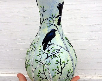 A Conspiracy of Ravens in Spring Sculpted with Polymer Clay onto a Recycled Glass Vase in Grayed Yellow