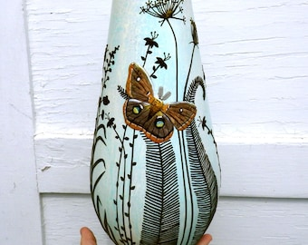 Brown Moth Amongst the Wildflowers Sculpted with Polymer Clay onto a Recycled Glass Vase in Neutrals