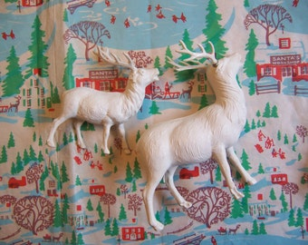 two white celluloid deer