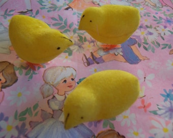 three tiny flocked chicks