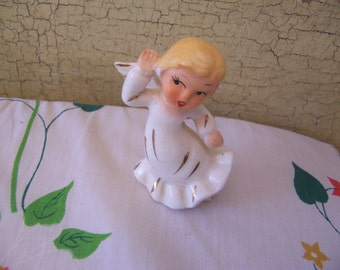 listening angel figurine