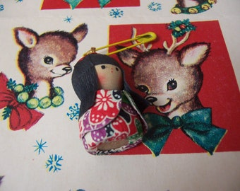 tiny little wooden doll charm