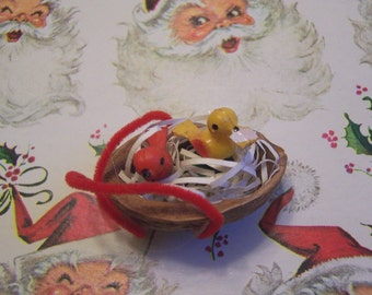 two itty bitty birds in a nutshell ornament