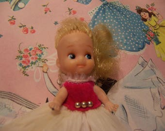tiny vintage rubber girly doll
