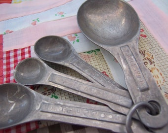 old aluminum measuring spoons