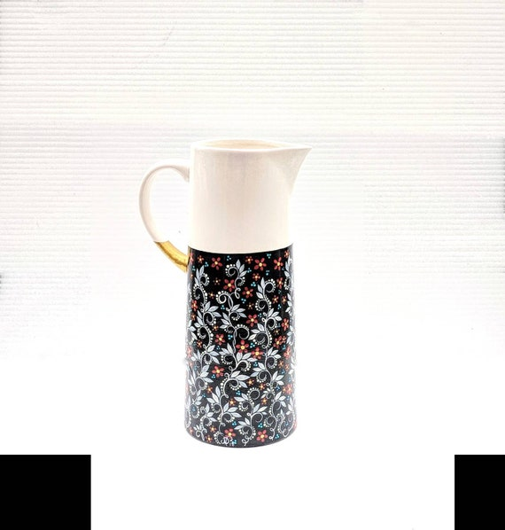 Pitcher: hand painted ceramic pitcher or vase
