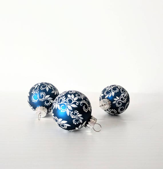 Tiny little ornaments white swirls leaves and dots on small royal blue glass ornaments