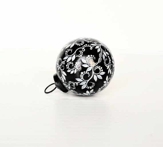 Black and white hand painted glass ornament swirls