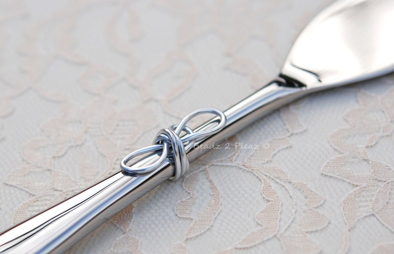 Infinity knot wedding cake cutter tying the knot cake knife image 0