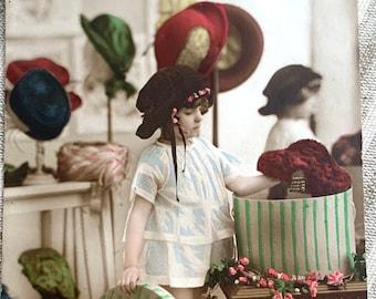 Antique Belgium Postcard of girl in Hat shop
