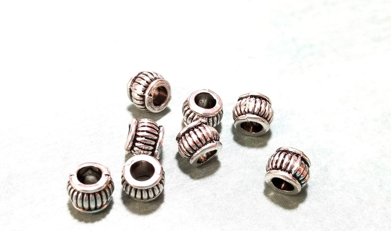 Antique Silver Rope Edged 5x6.5mm Barrel Spacer beads with an approx 20pcs Antique Silver Metal Beads Metal Spacers 3.2mm hole MB9052