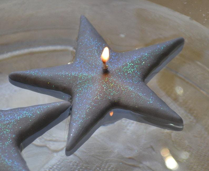 Silver Shimmering Star floating candles set of 10 image 0