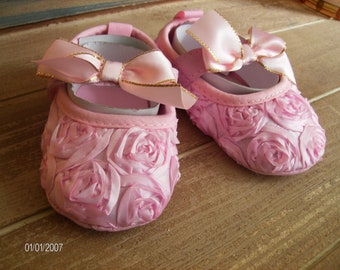 Pink ribbon rosebud soft soled shoes with Velcro straps for infants to 6 months