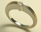 STERLING AND 14 KT. ATOMIC DIAMOND ENGAGEMENT RING