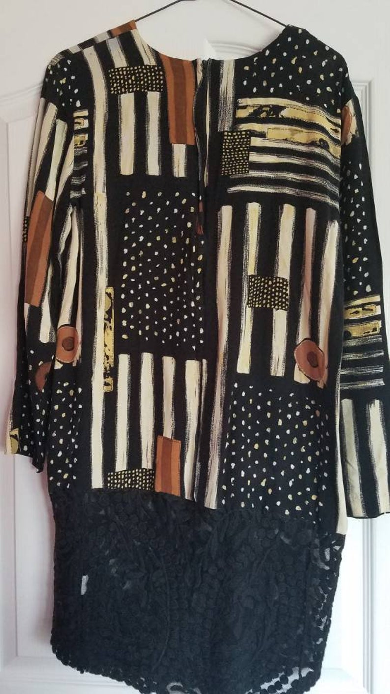 off-white browns asymmetrical print tunic with black lace along bottom long sleeve size 14 Refashioned black