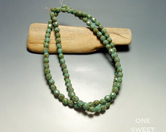 Faceted Blue Green with Picasso Czech Glass