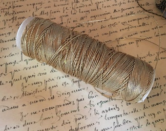 4yds Vintage GOLD METAL French Very Skinny Metallic Elastic. Doll supply, Costuming Supply