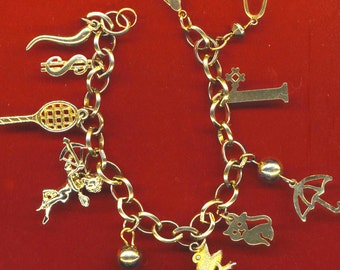 Vintage Gold Plated Charm Bracelet . Bee, Bell, Cat, Frog, Cupid, Number1, Dollar,Tennis Racket,Umbrella- Valentine by enchantedbeas on Etsy