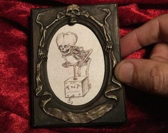 Baby Skeleton concept art (signed in sculpted frame)
