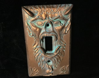 Devil with pince-nez light switch plate by Thomas Kuntz