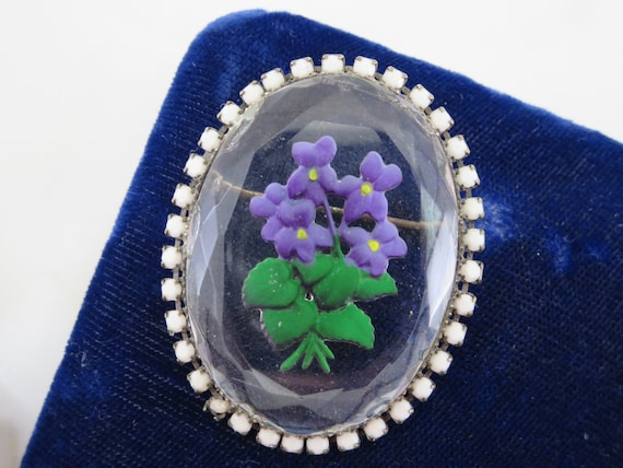 floral scene black background with purple blue and colorful flowers glass floral brooch flower pin Vintage glass flower brooch