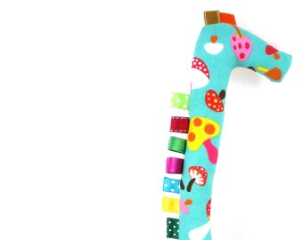 Handmade Taggy Giraffe Tactile Baby Toy - multicolored, rainbow diamond checks in canvas & colorful mushrooms on teal blue/green.