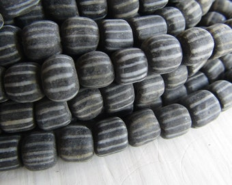 50 indonesian glass seed beads, black and white small spacer beads, barrel tube, New Indo-pacific  5 to 8mm (50 beads) 6ab66-4