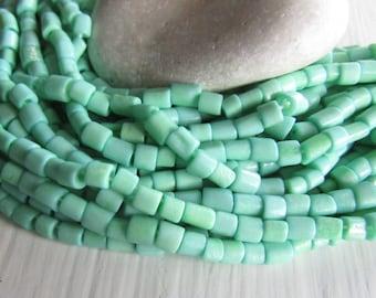 green tube bone beads, rondelle barrel spacer Bone beads, rough Irregular look,  boho exotic beads 4 to 7mm long  (50 beads) 7bb5-8