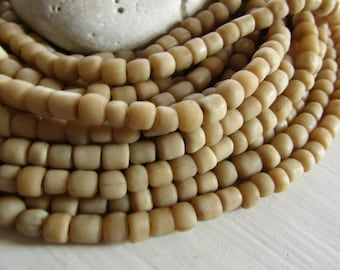 small matte beige seed glass bead,  matte opaque , irregular barrel tube spacer, New Indo-pacific 3 to 6 mm / 22 inche strand - 7ab29-32