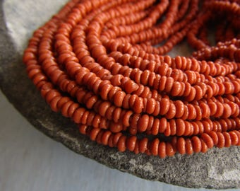 Mini tiny  Orange rondelle lampwork glass beads, delicate, opaque  semi matte, Indonesian ethnic 1 to 1.5 x 3mm ( 22 inches strand ) 7bb13-5