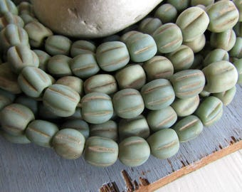 green lampwork glass beads, round melon wavy , matte opaque rustic gritty aged look , indonesian 9 to 11mm ( 12 beads) 7ab9-6