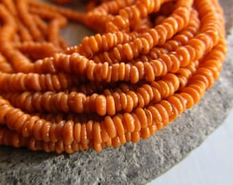 Mini tiny Orange no.2 rondelle lampwork glass beads, delicate, opaque  matte, Indonesian ethnic 1 to 1.5 x 3mm ( 22 inches strand ) 7bb13-3
