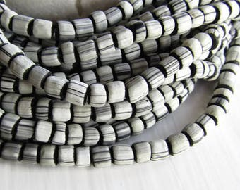 matte black white striped seed bead, small  ethnic  irregular barrel tube spacer, indonesia New Indo-pacific 3 to 6mm (22 inch strd) 7ab47