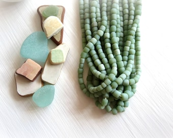 small matte green bead, soft green glass bead, irregular barrel tube spacer, New Indo-pacific 3 to 6 mm / 22 inche strand - 7ab29-1