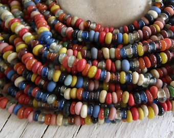 Rondelle lampwork glass beads, small spacer discs, multicolored mix, indonesian  5mm to 7mm dia (22 inch strand ) 21ab27-1