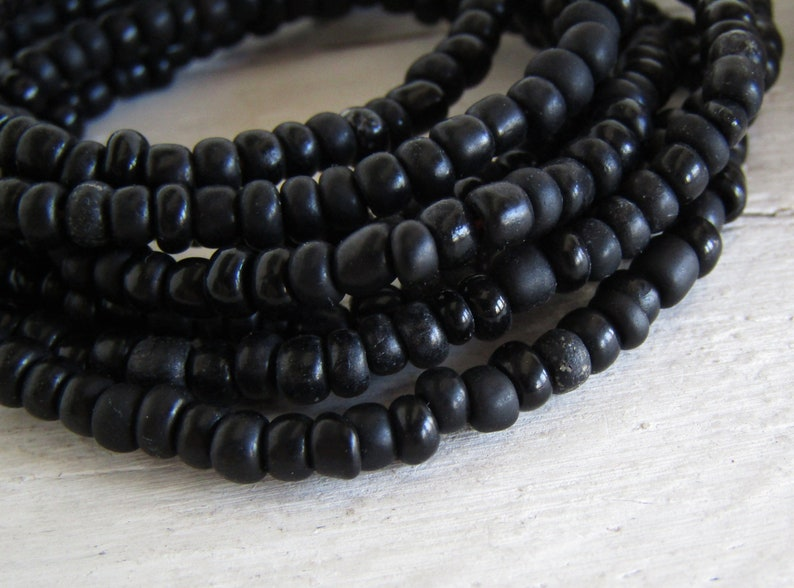 irregular organic tube barrel spacer Indonesia 3mm to 5mm dia small matte glossy black 44 inch strand 20ab1-10 black seed glass  beads