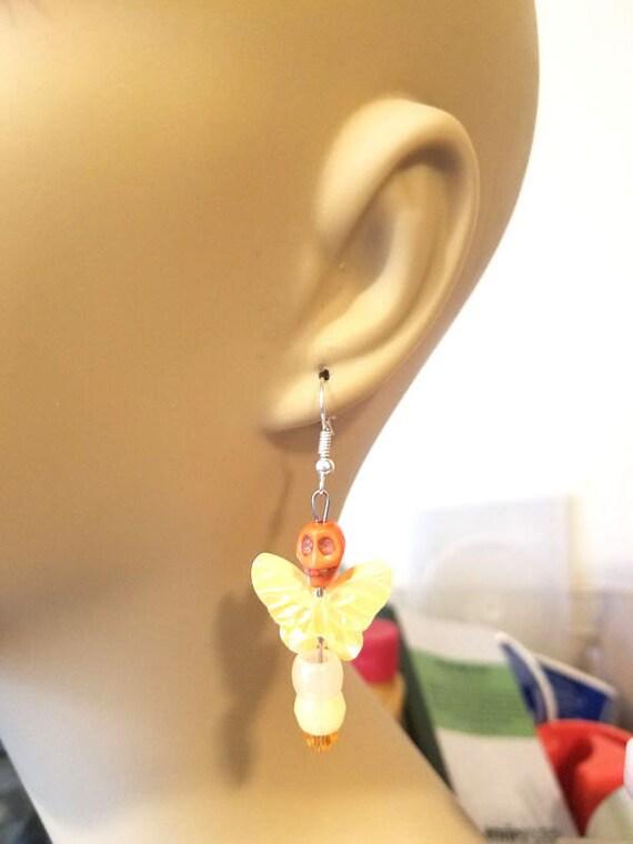 glow in the dark earrings sugar skull earrings butterfly dangles orange yellow goth day of the dead skeleton punk handmade jewelry