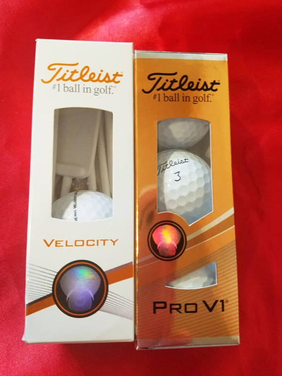 titleist golf balls and tees lot of two new boxes sports gifts Pro V1 Velocity